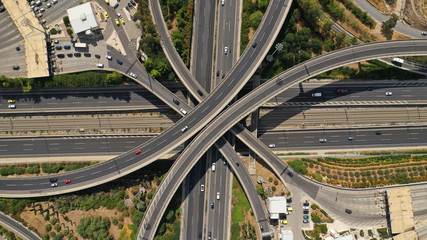 Aerial view of popular highway multilevel junction road, passing through National motorway and Attiki Odos, Attica, Greece