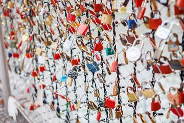 Closeup of love lockers at famous bridge Makartsteg in Salzburg, Austria.