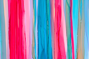 Vertical hand drawn pink and blue liquid ink colors blending. Bright colorful watercolor background.