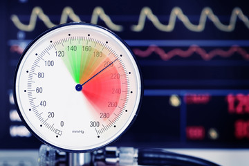 Blood pressure dial with arrow in the red danger zone, medical concept of arterial hypertension.