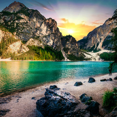 Amazing mountain lake in Alps - Lago di Braies over sunset. Dolomites, Italy