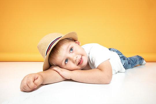 Happy kid in summer hat smiling.