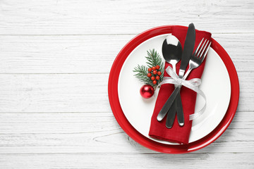 Fotobehang - Christmas table setting on white wooden background, top view. Space for text