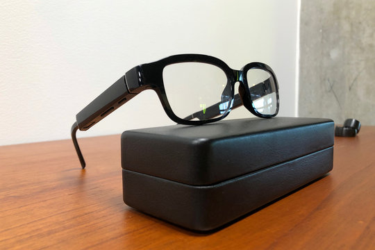 Amazon's new eyeglasses that come with its virtual assistant Alexa, the Echo Frames, rest on a display in Seattle