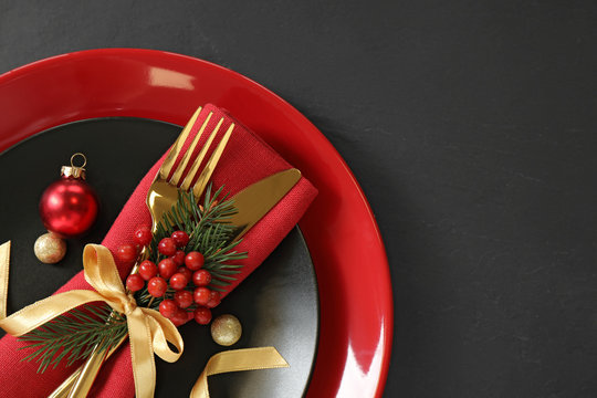 Beautiful Christmas table setting on black background, top view