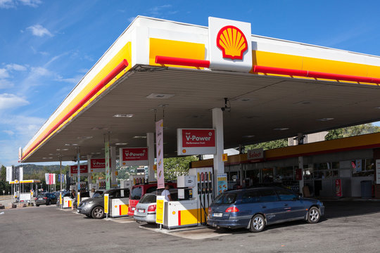 STOCKHOLM, SWEDEN-JUN, 2018: Drivers fill up their cars on the Shell petrol station in Stockholm city. Exterior of white and yellow building. Shell is largest oil company in the world