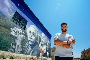 Man Painting Graffiti Along The Camino de Santiago