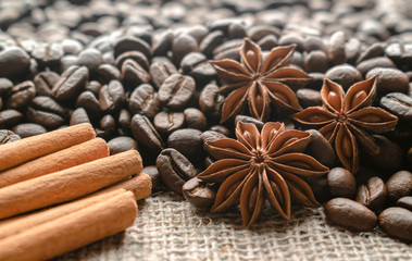 Coffee beans cinnamon and star anise. Whole grains with spices