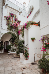 Cisternino, Italy - August 2019: Historic center of the village of Cisternino, in Puglia on a day in August