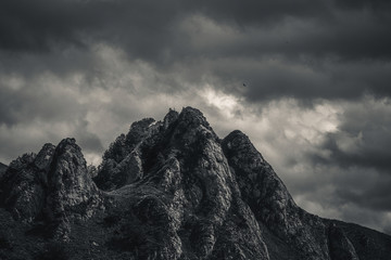 Mysterious black mountain with dramatic cloudy sky Wall mural