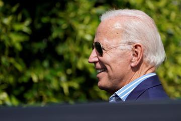 U.S. Democratic presidential candidate Joe Biden exits to an awaiting vehicle after attending a  fundraising event in Manhattan Beach, California