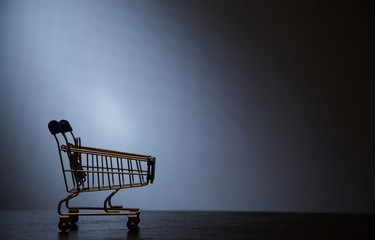 Black Friday, Shopping and sale concept. Supermarket and discount. The silhouette of the cart for shopping