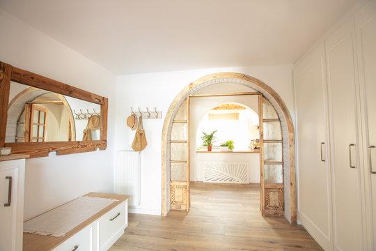 Big wooden handmade mirror in hallway.
