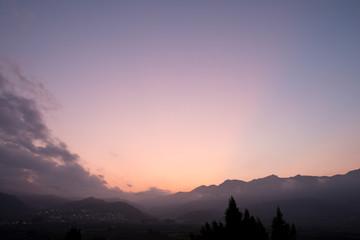 Wall Murals Light pink Mountain landscape at dusk