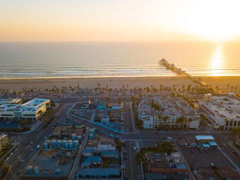 Huntington Beach ocean pier at sunset drone landscape views