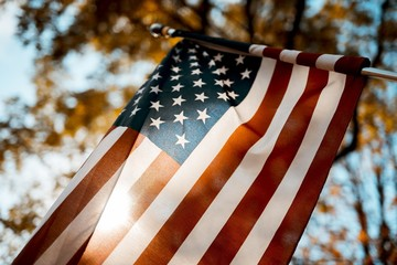 Flag of the united states shot from a low angle with a blurred background