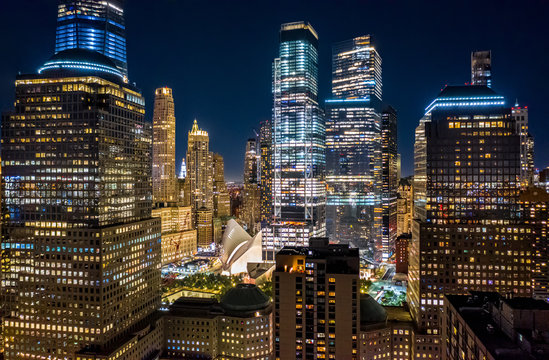 Aerial drone view of New York skyscrapers at night in Lower Manhattan