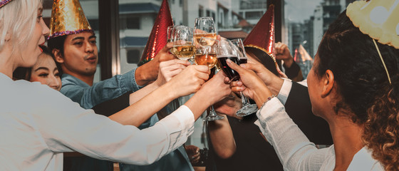 group of business people enjoying party and clinking glass of champagne and wine together to celebrate corporate success and new year event