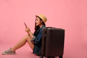woman backpacker traveler with passport money luggage. journey trip travel. studio shot
