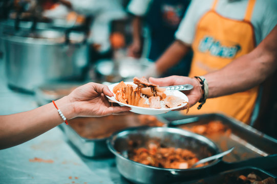 Philanthropists donate food and help the poor : concept of feeding