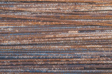 Background texture of old rusty steel bars construction materials in a construction site