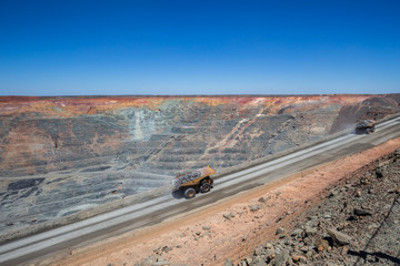 Loaded haulpaks climbing out of the Kalgoorlie Super Pit, one of the largest gold mines in the World. Gold was discovered in Kalggorlie in 1892.