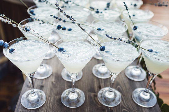 Set of cocktails with ice and blueberry on top on bar counter. Evening party reception