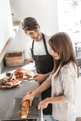 beautiful young couple preparing sandwiches for Breakfast