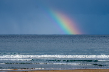 Rainbow and storm over the Southern ocean