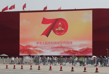 A giant screen is set up at Tiananmen Square in preparation for the 70th founding anniversary of People's Republic of China in Beijing
