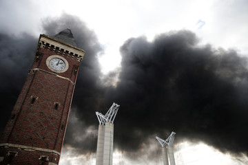 Plumes of smoke rise in the sky after a large fire broke out at the factory of Lubrizol in Rouen
