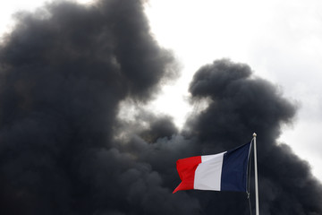 Dark smoke billows in the sky after a large fire broke out at the factory of Lubrizol in Rouen
