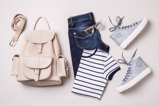 Clothing outfit - white backpack, jeans, striped t shirt, blue sneakers