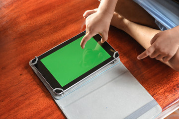 Hand of Children or Kid touch display screen of Tablet