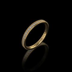 Gold wedding ring on black background-3D image