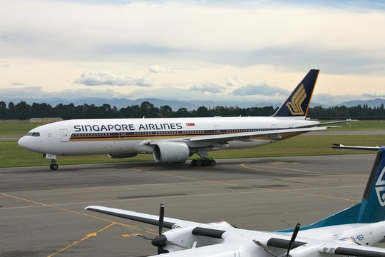 CHRISTCHURCH, NEW ZEALAND - MARCH 17, 2009: Singapore Airlines Boeing 777 at Christchurch Airport. Singapore Airlines had operating income of 359m SGD in FY 2013-2014.