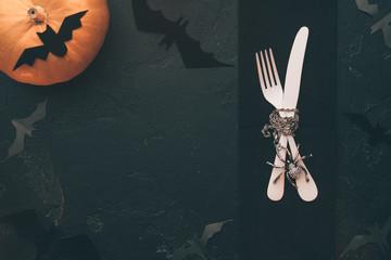 Photo of halloween pumpkin, knife, fork, bat .