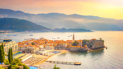 View of the old city of Budva, Montenegro. A sandy beach near the walls of the city (Richard the Head). Morning Mediterranean landscape. Fototapete