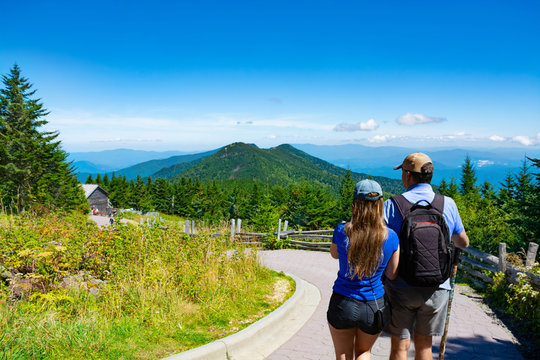 People hiking on summer vacation  in the  mountains. Couple enjoying time together in the mountains. Mount Mitchell State Park, North Carolina, USA