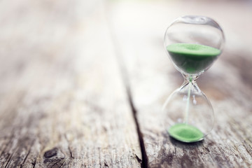 Green hourglass background concept for time or ecology and environmental conservation