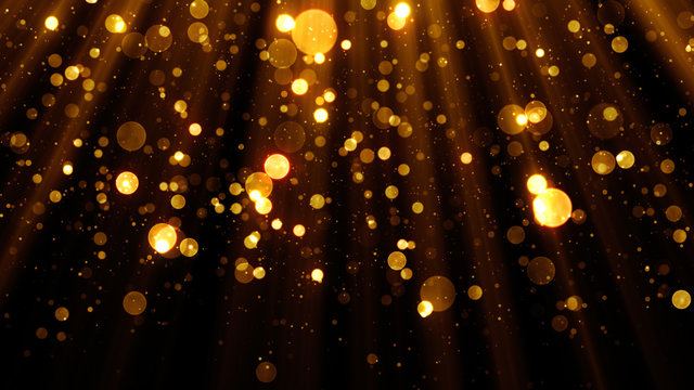 Glitter celebration texture with golden particles. Abstract background with magic lights and sparks.