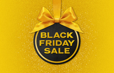 Fotomurales - Black Friday sale golden text write on black gift card ball with shiny ribbon bow, isolated on gold background