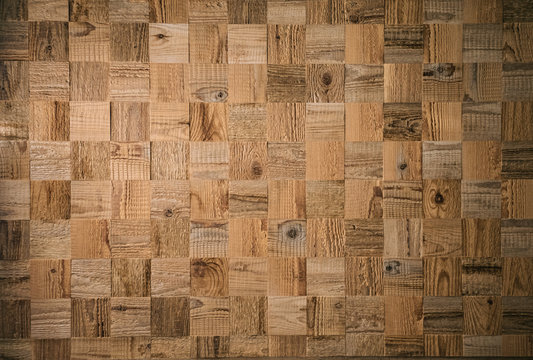 Square decorative wooden plank. Textured wood pattern. Mosaic of wooden cubes