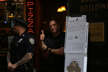 """A sign on a pizza box reads """"We Love Trump"""" outside a building where U.S. President Trump was attending a campaign fundraiser in New York"""