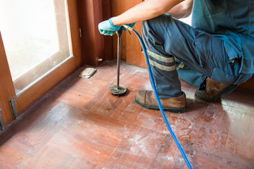 Termite control at home by using chemicals.Technicians compress chemicals into soil to prevent or kill underground termites.