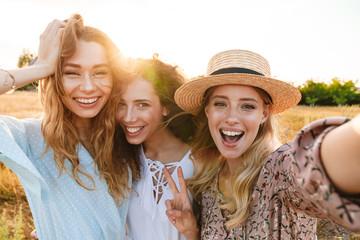 Photo of joyful caucasian women taking selfie photo
