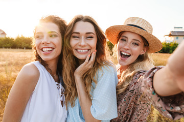 Photo of happy caucasian women taking selfie photo and laughing