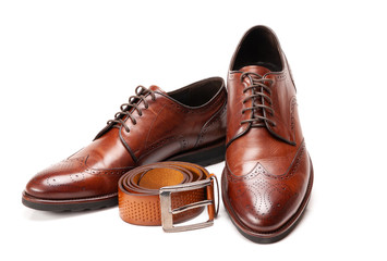 Men's patent leather shoes and belt on white