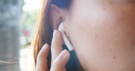 Young Asian Girl Using Headphones