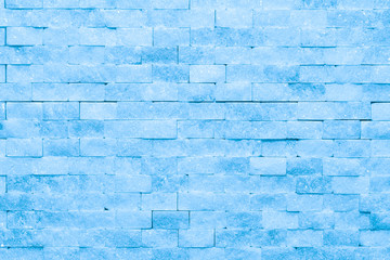Wall of blue ice bricks and blocks background texture